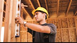 A carpenter working on the interior of a building