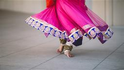 A photograph of a performer's feet dressed in traditional Indian costume