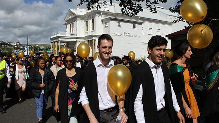 A photograph of a graduation procession