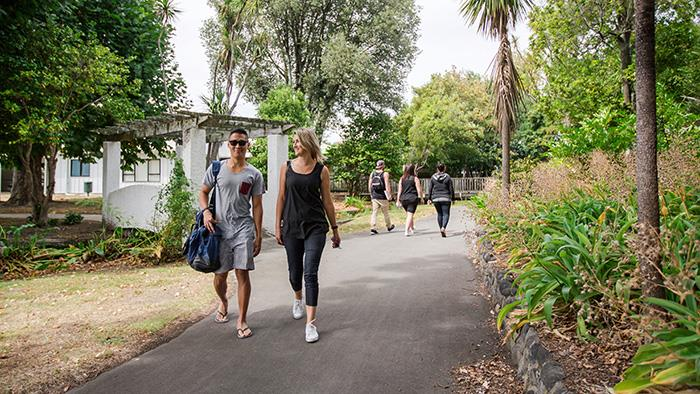 A photograph of some people walking together outdoors at UCOL in Wairarapa