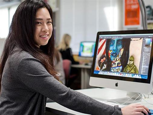 A photograph of a young lady at a computer