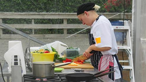 A photograph of UCOL Chef Training student Chavelle Hanger competing in the Woodhaven Gardens Cooking Competition.
