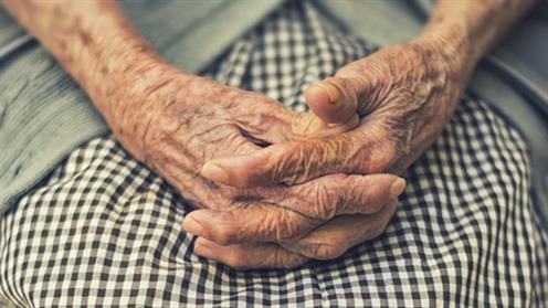 A photograph of an elderly person's hands