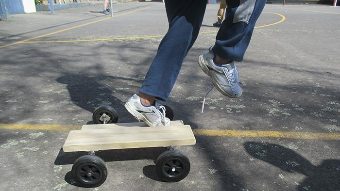 A person riding a peddle board
