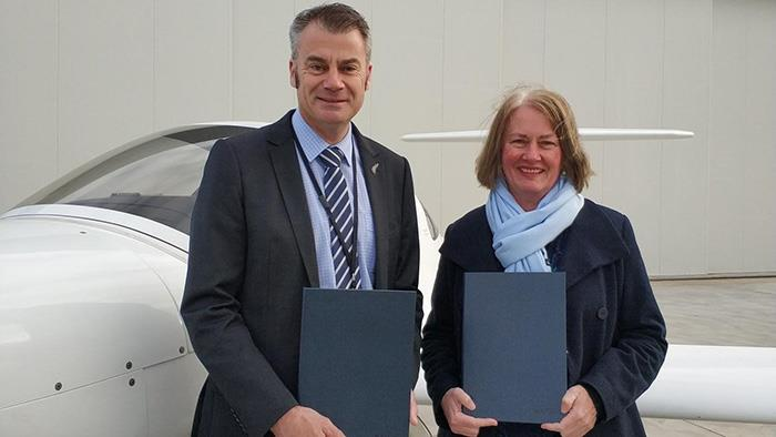 A photograph of New Zealand International Commercial Pilot Academy Chief Executive, Phil Bedford and UCOL Chief Executive Leeza Boyce.