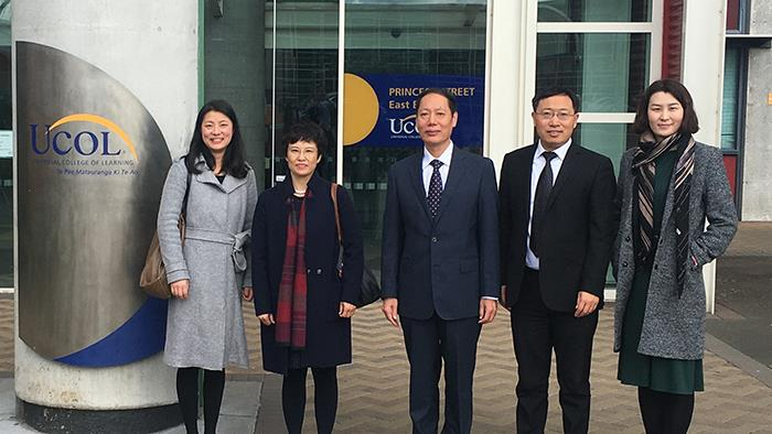 Delegates from UCOL and Shandong pose in front of UCOL in Palmerston North