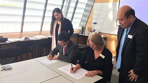 A photograph of the Vice President of Shanghai Polytechnic and Chief Executive of UCOL signing a memorandum of understanding.