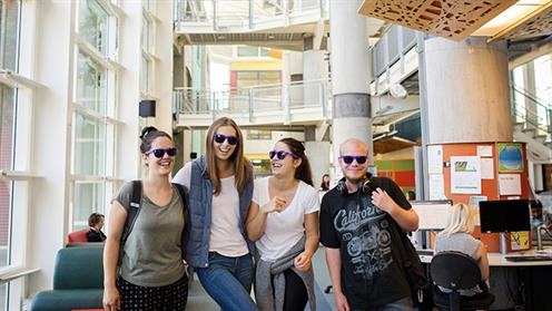 A group of students standing in the atrium at UCOL's Palmerston North campus