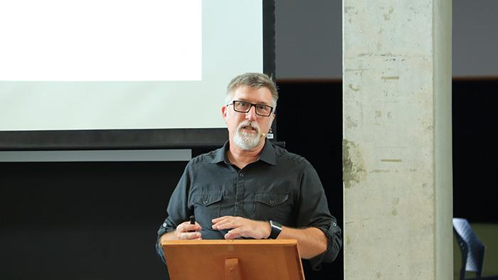 A photograph of UCOL Senior Lecturer Ian Rotherham speaking at an event