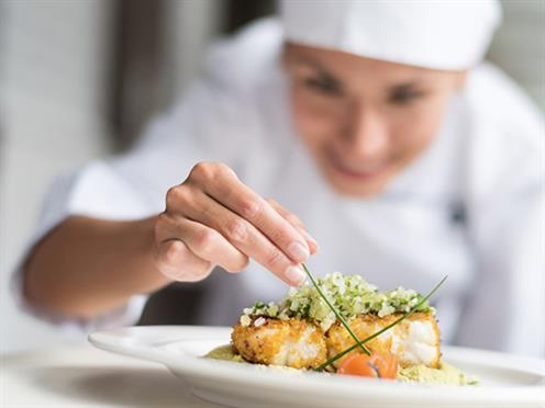 A chef prepping a dish.