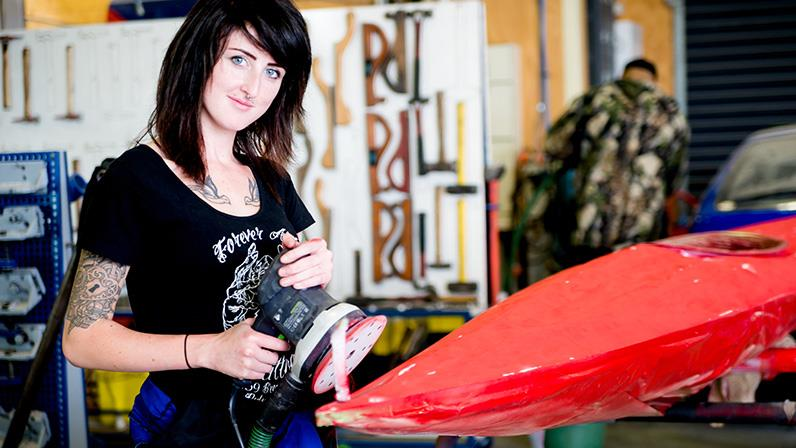 An Automotive Panel & Paint student prepares a kayak for painting
