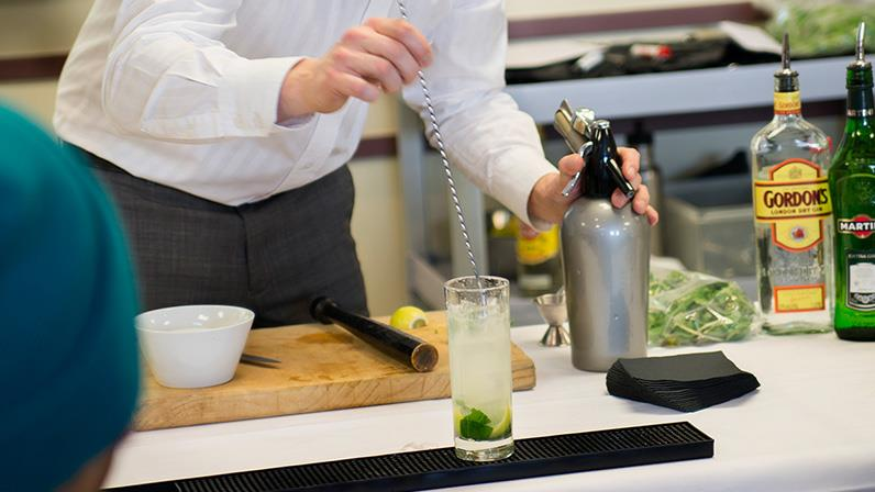 A Hospitality lecturer demonstrates how to make a mojito