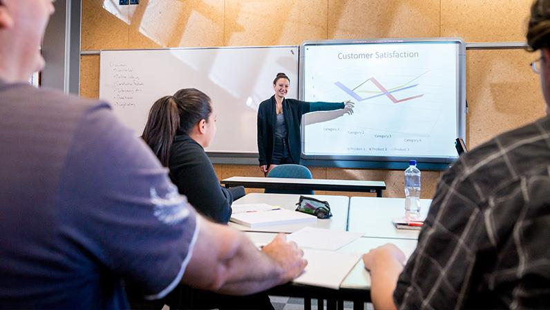 Students learning business principles at our Whanganui Campus