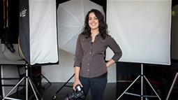 A lady in a photography studio holding a camera