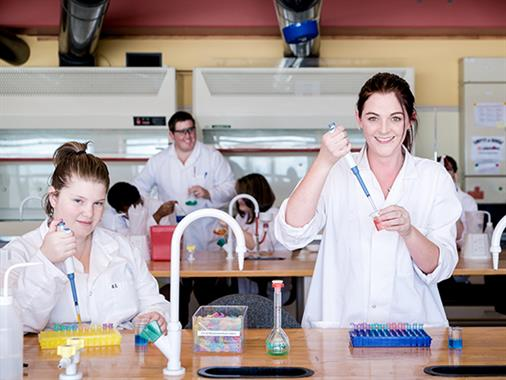 A photograph of two ladies in a science laboratory