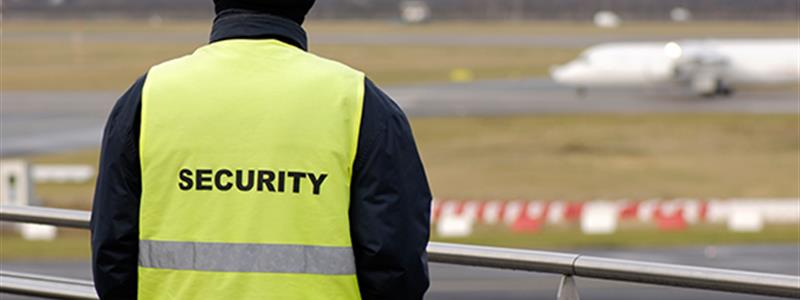 A security guard stands watching at an airport