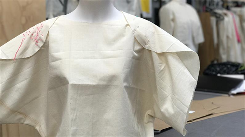 A garment tacked together on a model