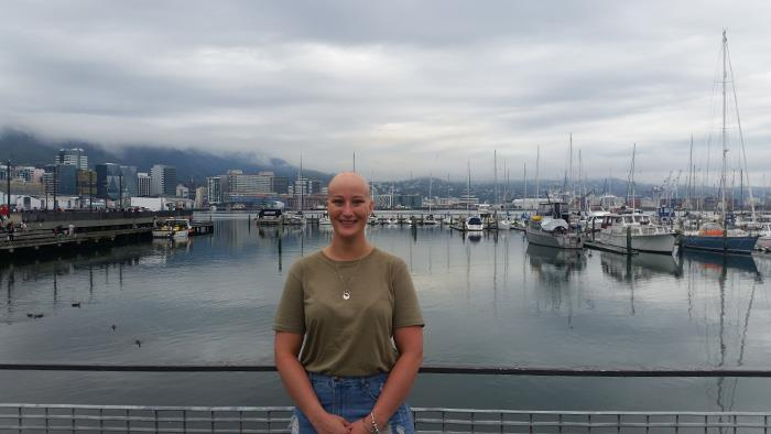 A photograph of UCOL Bachelor of Teaching graduate Ina Devine standing on Wellington harbour.