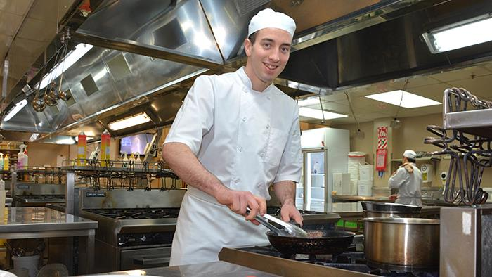 A photograph of Zach Means in UCOL's commercial kitchen